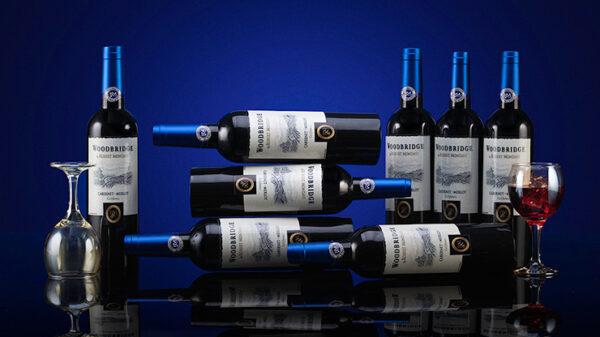 Sky Multiplying Wine Bottles by Tora Magic
