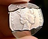 Bitten 50 Pence and Coin in Bottle